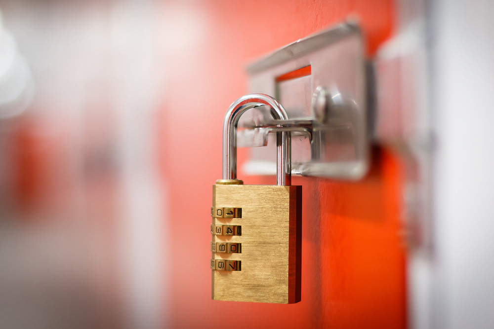 Picture of a combination lock with orange background