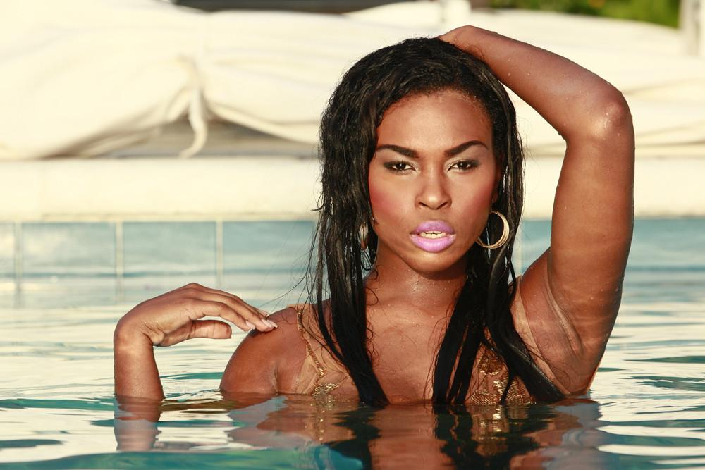 Black Caribbean Woman in the pool looking seductive