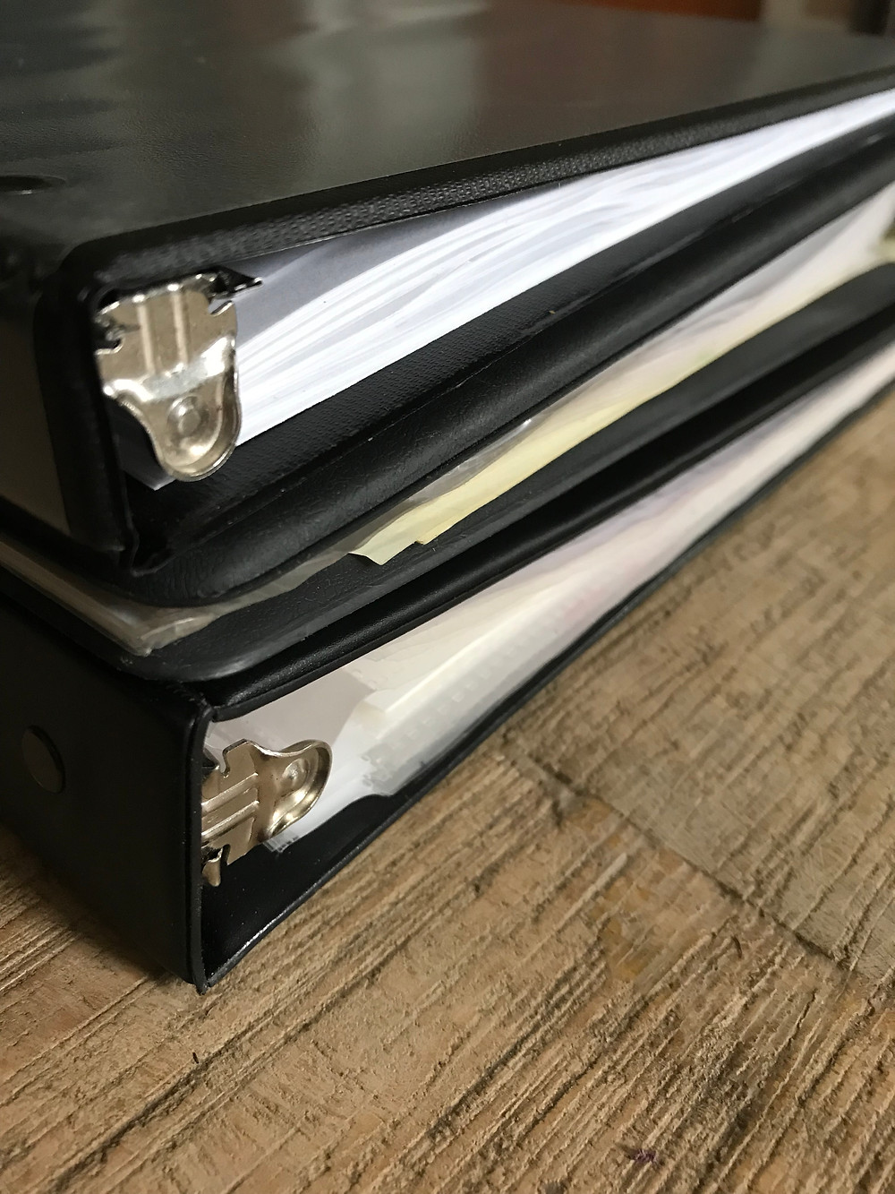 Binders full of policy and benefit information.