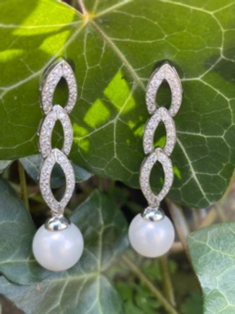 Handmade sterling earrings,with pearL and Swarovski crystals.