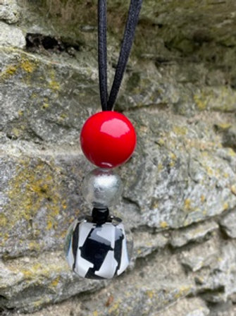 Handmade resin necklace.