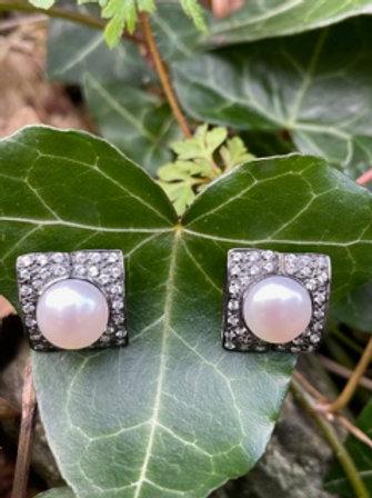Sterling silver earrings,black rhodium,cultured pearls,and Swarovski