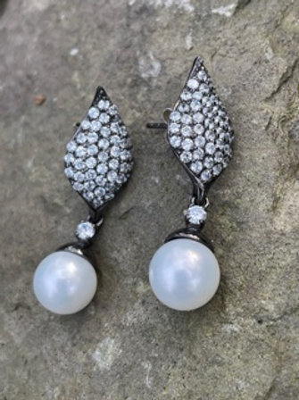 Handmade sterling silver earrings,Swarovski,and shell pearl.
