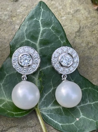 Sterling Silver earrings with shell pearl,and Swarovski.