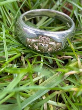 Sterling silver Claddagh ring with 14k gold hands,heart and crown.