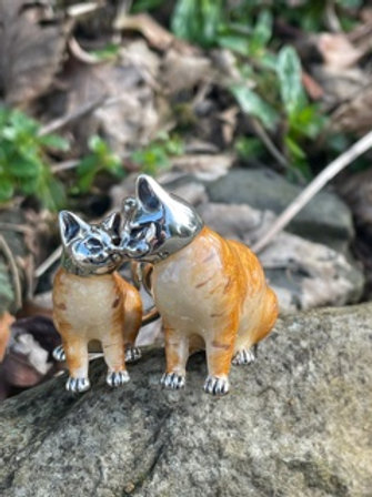 Sterling silver handmade pair of cats.