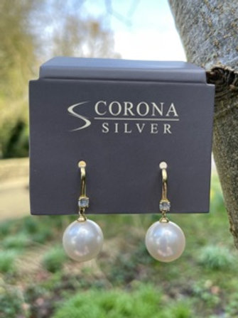 Sterling silver,18kgold plated,shell pearl.