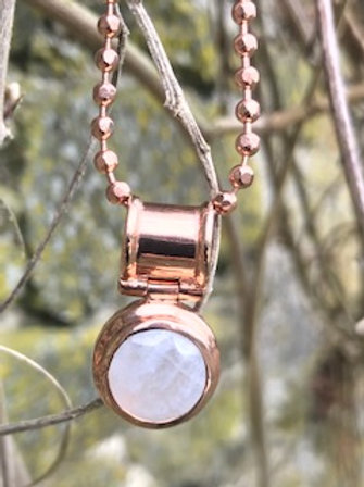 Sterling silver pendant and chain,with 18k rose plating,and rainbow moonstone.