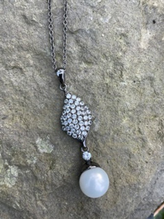 Sterling silver pendant,oxidized,withSwarovski crystal,andpearl.