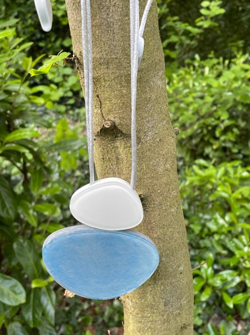 Adjustable handmade resin pendant.