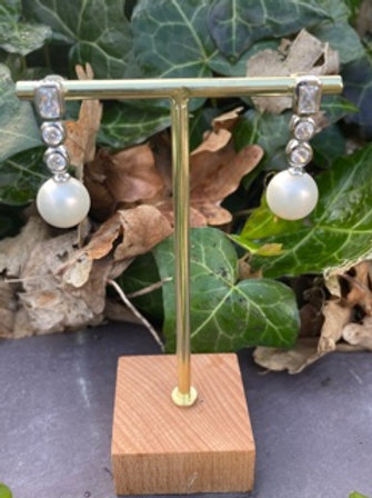 Sterling silver earrings,hand crafted, with shell pearl.