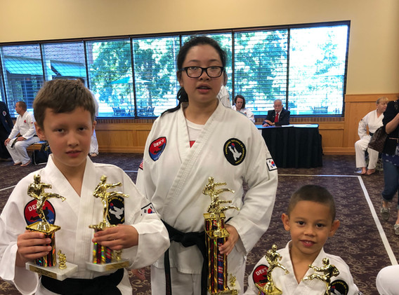 Jaylee, Tracy and Anthony demonstrate Black Belt success.