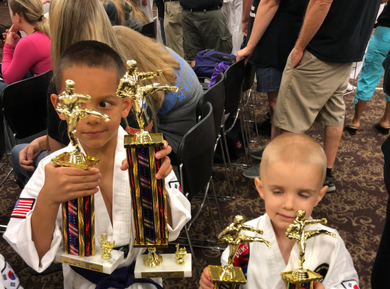Two young men earn their first trophies!