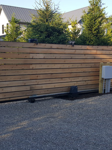 Wood clad gate, rack sliding gate operator