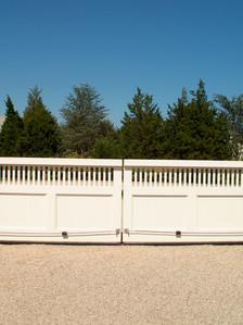 Wood clad bi-parting chain sliding gates