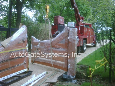 Wooden Gate install with crane Watermark