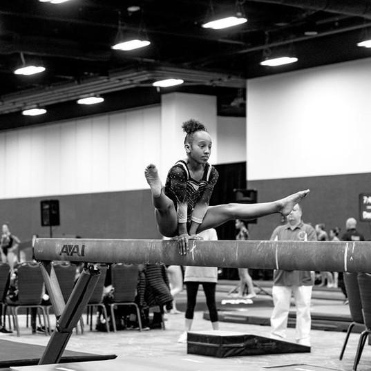 CaMarah showing off her strength on beam