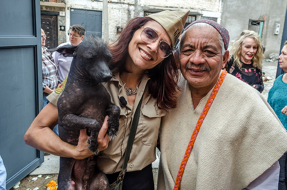 Contemporary artist, Isis Rodriguez poses with Zapotec healer, Paco Rodriguez and his xoloitzcuintle, Nagual.