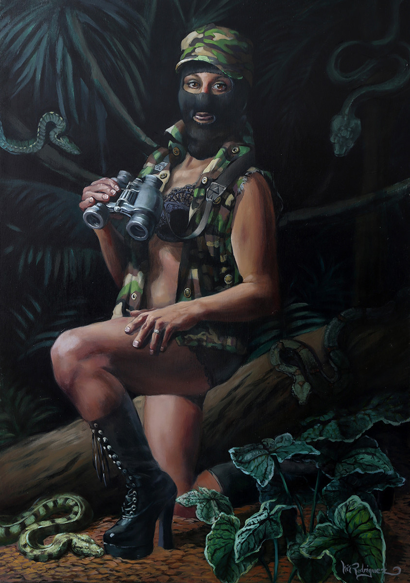 A woman wearing a zapatista mask in a jungle.