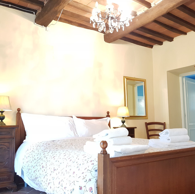 Bedroom in Villa Cecchini with Ensuite Bathroom