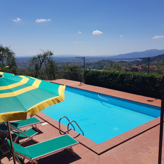 pool view on a warm summer day in Villa Cecchin