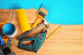 House renovation tools on turquoise pain
