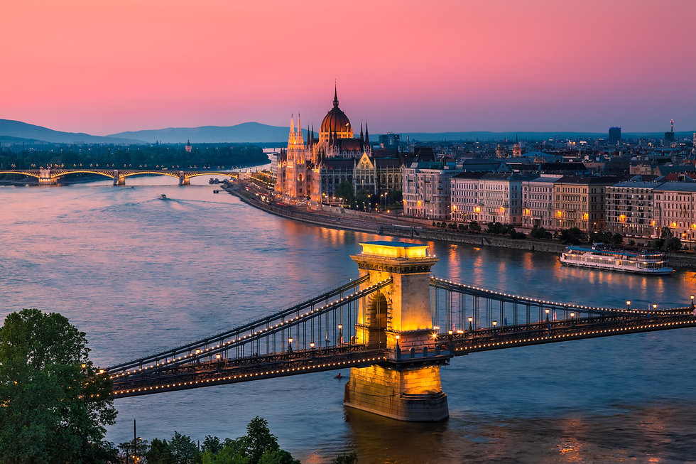 Panorama of Budapest, Hungary, with the Parlament building on display on the banks of the Danube river. Evening Star Travel Sherwood Park Edmonton Travel Agent Advsior Wanderlust River Cruise Beach Vacation Trip