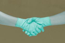 glove hand shake green