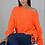 Thumbnail: In orange geflochtenem Pullover gestrickt
