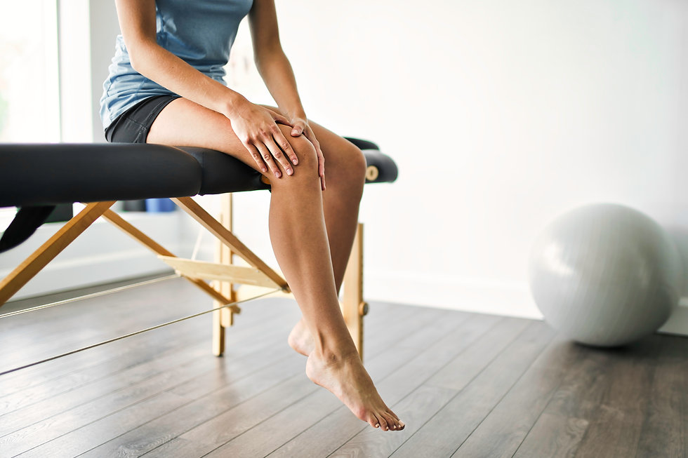 Modern rehabilitation physiotherapy place with woman client.jpg