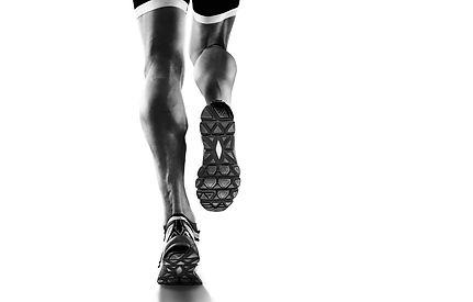 Sports background. Runner feet running c