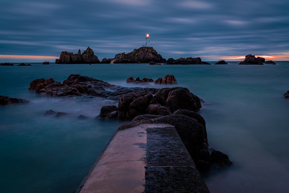 La Corbiere lighthouse at high tide at sunset