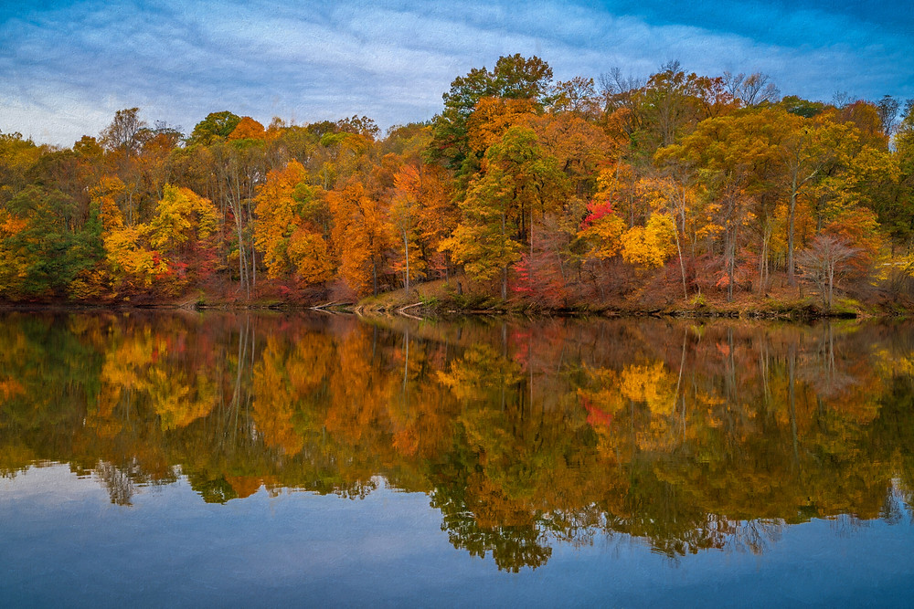Autumn colors and their lake reflection
