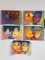[Image description: A collection of abstract drawings of cats.]