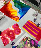 [Image description: An image of various artwork laid out on a table.]