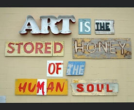 [Image description: An image of typography art that says 'Art is the stored honey of the human soul.']