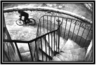 Henri Cartier-Bresson – Man cycling down the street