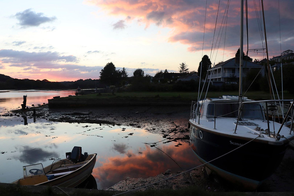 Low tide sunset shot with beached boats