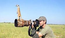 Meercat on camera lens