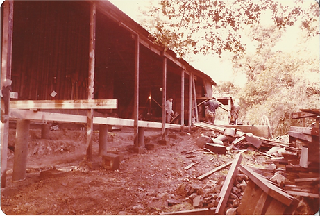 An old photograph of Sonoma Mountain Zen Center zendo under construction