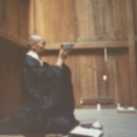 young Jakusho Kwong-roshi eating oryoki meal