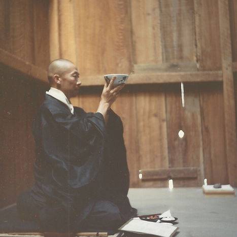 young Jakusho Kwong-roshi eating oryoki meal