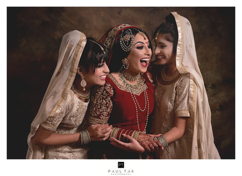 Laughing bride and brides maids asian we