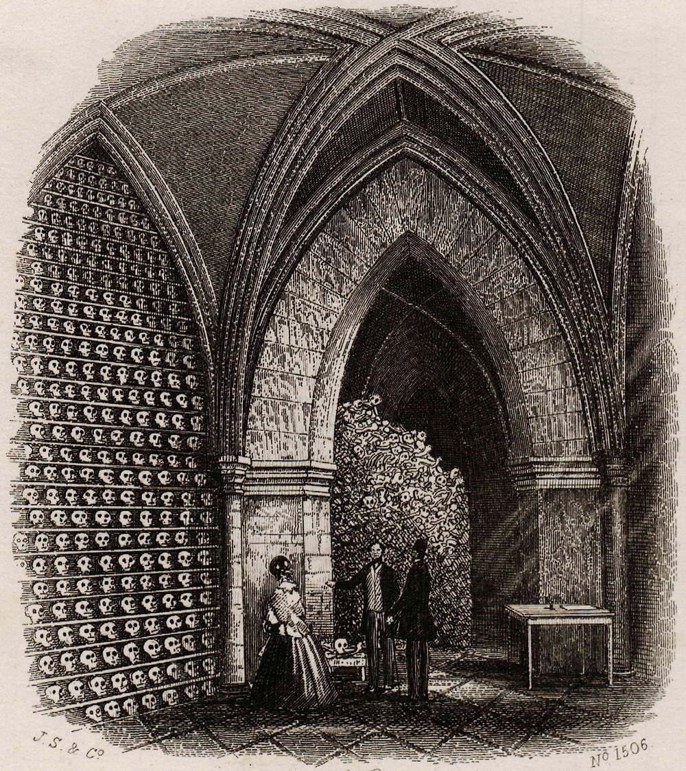 Extant charnels attracted tourists when interest in them rose in the 19th century. Here, visitors are shown inspecting a gothically exaggerated depiction of the Hythe ossuary, c.1865.  Details: J.S. & Co. (c.1860s) Illustrations of Hythe. Hythe: W.S.Paine.