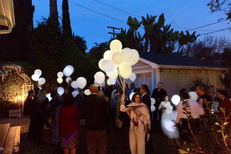 Holding glowing balloons.jpg