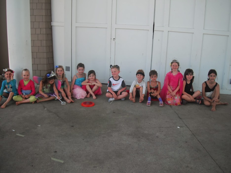 campers in costumes sitting in line
