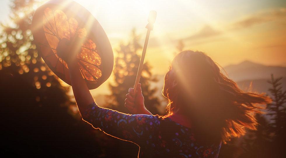 beautiful shamanic girl playing on shama