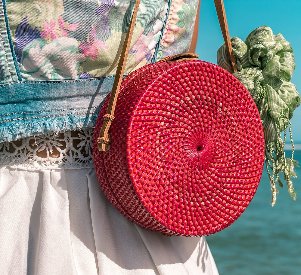 A close up photo of a red basket bag