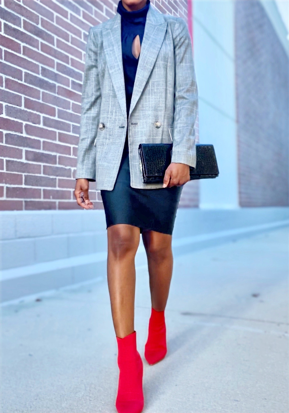 Plaid blazer layered over a black roll neck top and a fitted black pencil skirt