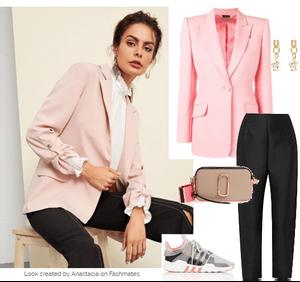 Woman wearing a stylish pale pink blazer